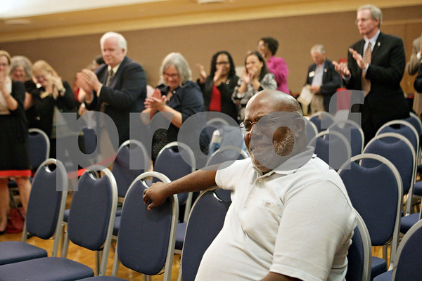 Rob Winner – rwinner@shawmedia.com<br /> <br /> Former CHANCE Program director Leroy Mitchell reacts while receiving a standing ovation from the audience during an awards ceremony at the Regency Room on the Northern Illinois Campus in DeKalb on Friday, Oct. 4, 2013. Mitchell was the director for 28 years. CHANCE stands for counseling, help and assistance necessary for a college education.