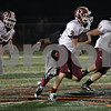 Rob Winner – rwinner@shawmedia.com<br /> <br /> Morris quarterback Griffin Sobol (2) carries the ball during the second quarter in DeKalb, Ill., Friday, Oct. 11, 2013.