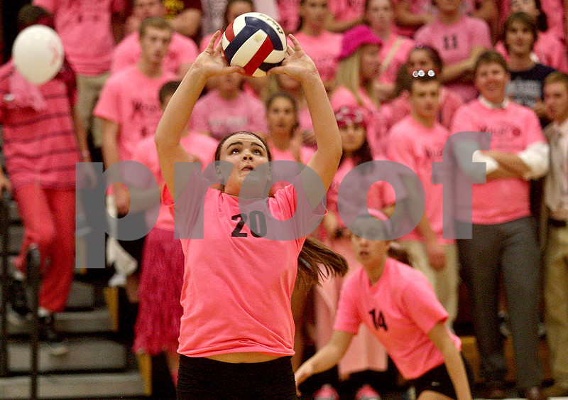 Monica Maschak - mmaschak@shawmedia.com<br /> Madison Lord sets up the ball for the next hit in the second of two sets at Sycamore High School on Thursday, October 10, 2013. DeKalb won the match.