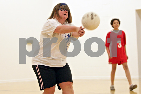 Rob Winner – rwinner@shawmedia.com<br /> <br /> Mary Cosentino, 38, bumps a volleyball during practice at Opportunity House in Sycamore, Ill., Monday, Oct. 7, 2013.