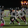 Rob Winner – rwinner@shawmedia.com<br /> <br /> DeKalb quarterback Jack Sauter (7) hands the ball off to running back Dre Brown (33) who would score after a 97-yard touchdown run during the first quarter in DeKalb, Ill., Friday, Oct. 11, 2013.