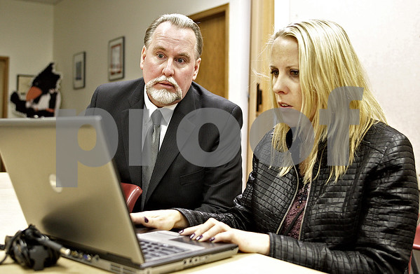 Monica Maschak - mmaschak@shawmedia.com<br /> Doug Moeller and Bilingual Programs Coordinator and Homeless Liason Amy Cook look at some documents during a meeting with District 428 principals and administrators on Wednesday, October 9, 2013. Moeller is the district's next superintendent.