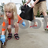 Monica Maschak - mmaschak@shawmedia.com<br /> Sadie Lang, 3, picks up garbage in front of the Sycamore Post Office as part of Kids Word Day on Saturday, October 5, 2013. Local children volunteered to rid Downtown Sycamore of litter to prepare for this year's Pumpkin Festival.