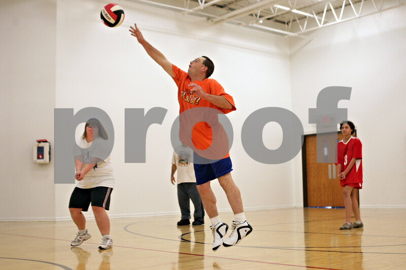 """Rob Winner – rwinner@shawmedia.com<br /> <br /> Kevin Koch, 36, leaps for a volleyball during practice at Opportunity House in Sycamore, Ill., Monday, Oct. 7, 2013. """"It's fun and I can talk to my friends and we can help each other out,"""" said Koch when asked why he likes to play."""