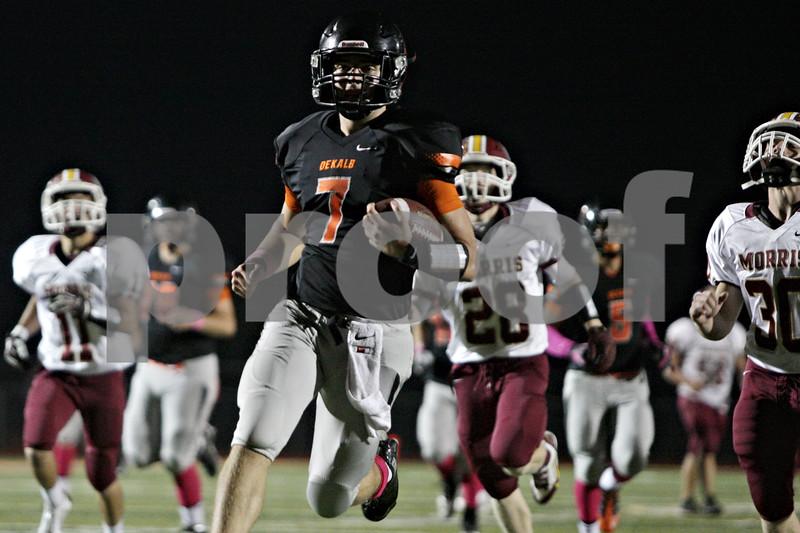 Rob Winner – rwinner@shawmedia.com<br /> <br /> DeKalb quarterback Jack Sauter (7) carries the ball into the end zone for a 42-yard touchdown run during the second quarter in DeKalb, Ill., Friday, Oct. 11, 2013.