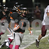 Rob Winner – rwinner@shawmedia.com<br /> <br /> DeKalb's Tony Tate (1) carries the ball for a big gain during the first quarter in DeKalb, Ill., Friday, Oct. 11, 2013.