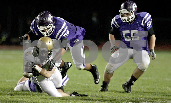 Monica Maschak - mmaschak@shawmedia.com<br /> Wide receiver Jake Winters cradles the ball as he is taken down during the second quarter at Rochelle on Friday, October 11, 2013.