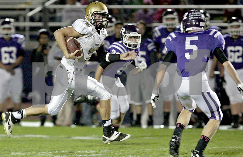 Monica Maschak - mmaschak@shawmedia.com<br /> Quarterback Devin Mottet carries the ball during the first quarter at Rochelle on Friday, October 11, 2013.
