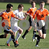 Monica Maschak - mmaschak@shawmedia.com<br /> Austin Mereness finds himself chasing the ball between two DeKalb players in the first half of the game at Sycamore High School on Thursday, October 10, 2013. DeKalb beat Sycamore 7-0.