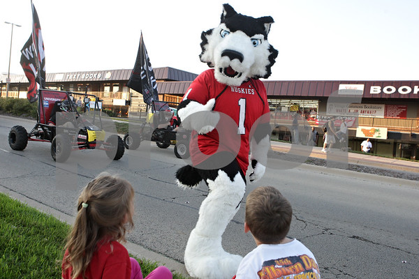 Rob Winner – rwinner@shawmedia.com<br /> <br /> Victor E. Huskie gives a thumbs up to Emily Ramm (left), 5, and her brother Joey Ramm, 7, during the Northern Illinois University homecoming parade while marching east on Lucinda Avenue in DeKalb, Ill., Friday, Oct. 11, 2013.