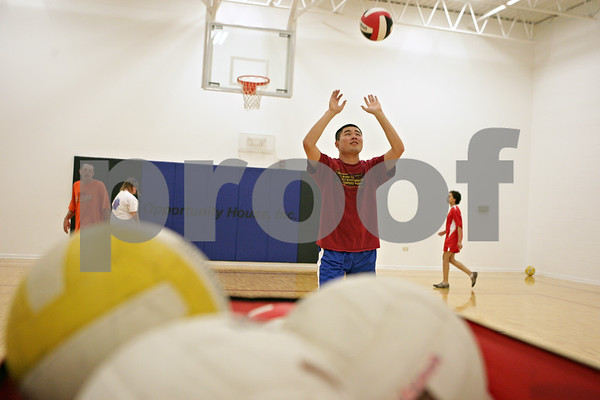 Rob Winner – rwinner@shawmedia.com<br /> <br /> David Roberts, 28, attempts to set a ball during volleyball practice at Opportunity House in Sycamore, Ill., Monday, Oct. 7, 2013.