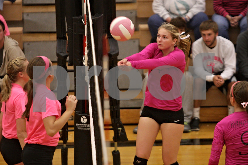 Rob Winner – rwinner@shawmedia.com<br /> <br /> Kaneland's Riley Hannula (14) bumps the ball during the second game against DeKalb on Tuesday, Oct. 15, 2013. DeKalb defeated Kaneland, 25-17 and 25-15.