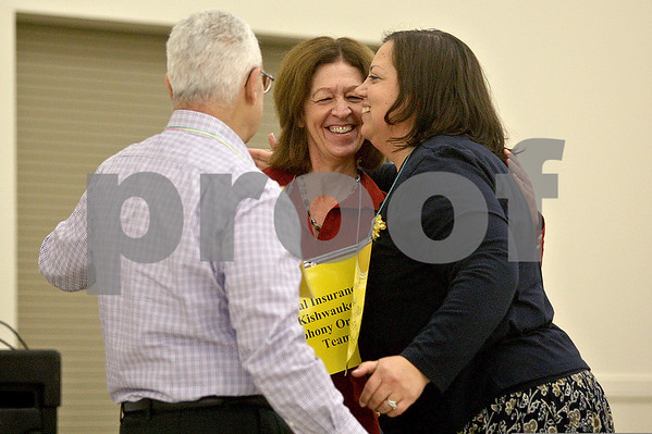 Monica Maschak - mmaschak@shawmedia.com<br /> Jerry Zar (from left), Lynn Vogl and Christine Monteiro congratulate each other after correctly spelling irreconcilable in the 10th round to win the 14th Annual DeKalb County Community Spelling Bee at St. Mary's in Sycamore on Thursday, October 17, 2013. The bee raises money for literacy programs DeKalb County.