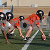 Rob Winner – rwinner@shawmedia.com<br /> <br /> DeKalb center Wes Leffelman (center) prepares to snap the ball during practice in DeKalb on Monday, Oct. 14, 2013.