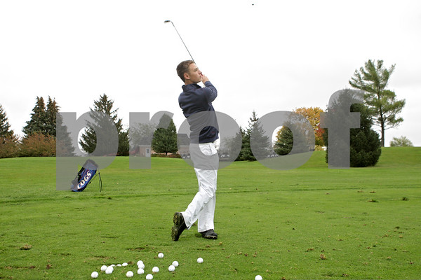 Rob Winner – rwinner@shawmedia.com<br /> <br /> Sophomore Tommy Lucca practices at the Oak Club of Genoa on Wednesday, Oct. 16, 2013.
