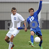 Erik Anderson - For the Daily Chronicle<br /> The Cog's Cody Rice controls the ball as the Warrior's Robbie Kleczynski attempts to steal during the Class A Regional Semi-Finals against Westminster Christian at Genoa-Kingston High School in Genoa on Wednesday, October 16, 2013.