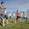 Rob Winner – rwinner@shawmedia.com<br /> <br /> (From left to right) Brandon Jakubiec, Katie Hoffman, Kristen Clark and Audrey Harrod are seen stretching during cross country practice at Hinckley-Big Rock High School on Monday, Sept. 30, 2013.