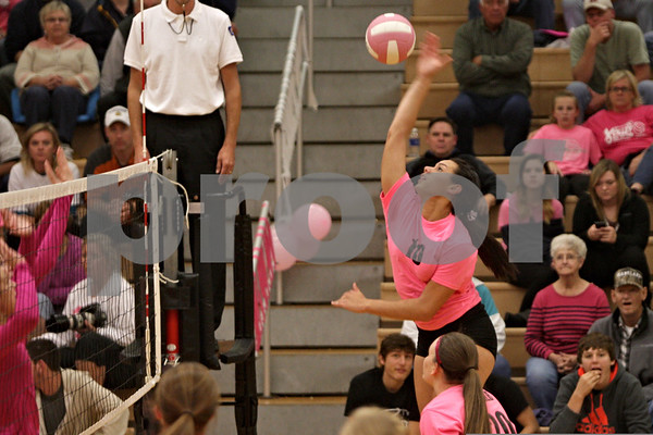 Rob Winner – rwinner@shawmedia.com<br /> <br /> DeKalb's Alexis Hammond goes up for a ball during the first game against Kaneland on Tuesday, Oct. 15, 2013. DeKalb defeated Kaneland, 25-17 and 25-15.