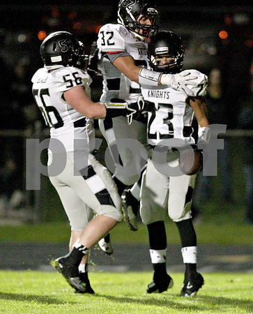 Monica Maschak - mmaschak@shawmedia.com<br /> Offensive lineman Sam Bower and running back Nate Dyer congratulate running back Isaac Swithers on scoring the first touchdown in the first quarter between the Spartans and the Knights on Friday, October 18, 2013.