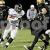 Monica Maschak - mmaschak@shawmedia.com<br /> Running back Nate Dyer carries the ball in the first quarter between the Spartans and the Knights on Friday, October 18, 2013.