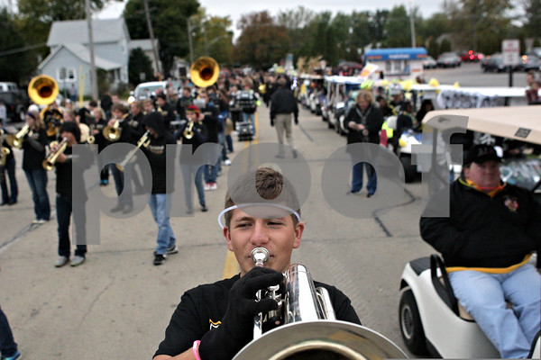 Rob Winner – rwinner@shawmedia.com<br /> <br /> Ryan Guss practices with the marching band before the start of the Sycamore High School homecoming parade on Wednesday, Oct. 16, 2013.