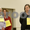 Monica Maschak - mmaschak@shawmedia.com<br /> Christine Monteiro (right) spells the word irreconcilable for her team in the 10th round to win the 14th Annual DeKalb County Community Spelling Bee at St. Mary's in Sycamore on Thursday, October 17, 2013. Monteiro's teammates were Jerry Zar (left) and Lynn Vogl. The bee raises money for literacy programs DeKalb County.