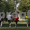 Rob Winner – rwinner@shawmedia.com<br /> <br /> (From left to right) Brandon Jakubiec, Katie Hoffman, Kristen Clark and Audrey Harrod are seen during cross country practice at Hinckley-Big Rock High School on Monday, Sept. 30, 2013.