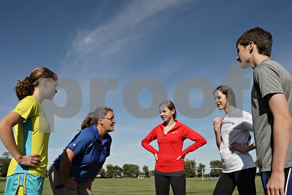 Rob Winner – rwinner@shawmedia.com<br /> <br /> Hinckley-Big Rock cross country coach Kristy Harrod (second from left) talks with her team which includes Audrey Harrod (from left to right), Kristen Clark, Katie Hoffman and Brandon Jakubiec during practice in Hinckley, Ill., Monday, Sept. 30, 2013.