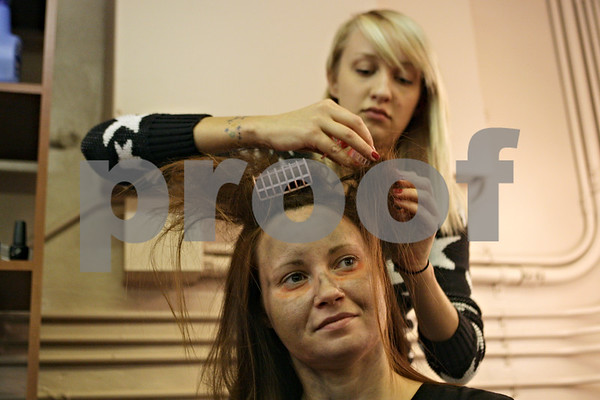 Rob Winner – rwinner@shawmedia.com<br /> <br /> Ginger McQueen (front) has her hair done by Meghanne Findlay before the first night of the Amenti Haunted House at the Egyptian Theatre in DeKalb, Ill., Friday, Oct. 18, 2013.