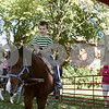 "Rob Winner – rwinner@shawmedia.com<br /> <br /> On Monday afternoon, Jaden Rogers, 5, of DeKalb says ""giddy-up,"" during a pony ride outside the DeKalb Public Library as part of the Big Read event recognizing the book ""True Grit."""