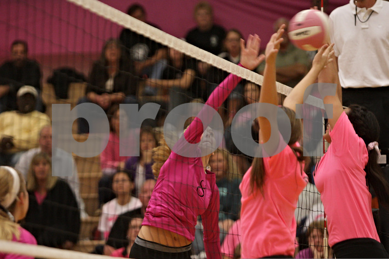 Rob Winner – rwinner@shawmedia.com<br /> <br /> Kaneland's Anna Senese (8) tries to tip a ball over the net during the first game against DeKalb on Tuesday, Oct. 15, 2013. DeKalb defeated Kaneland, 25-17 and 25-15.