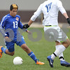 Erik Anderson - For the Daily Chronicle<br /> The Cog's Juan Lechuga runs past Warrior defender David DiGrazia during the Class A Regional Semi-Finals against Westminster Christian at Genoa-Kingston High School in Genoa on Wednesday, October 16, 2013.