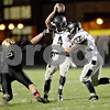 Monica Maschak - mmaschak@shawmedia.com<br /> Defensive tackle Derek Stenberg hooks onto th face mask of quarterback Drew David in the second quarter between the Spartans and the Knights on Friday, October 18, 2013.