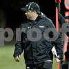 Monica Maschak - mmaschak@shawmedia.com<br /> Head coach Tom Fedderly paces in the second quarter between the Spartans and the Knights on Friday, October 18, 2013.
