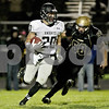 Monica Maschak - mmaschak@shawmedia.com<br /> Wide receiver Dylan Nauert rushes forward followed by defensive end Austin Kosunik in the second quarter between the Spartans and the Knights on Friday, October 18, 2013.