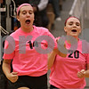 Rob Winner – rwinner@shawmedia.com<br /> <br /> DeKalb's Courtney Wagner (left) and Madison Lord celebrate a DeKalb point during the first game against Kaneland on Tuesday, Oct. 15, 2013. DeKalb defeated Kaneland, 25-17 and 25-15.