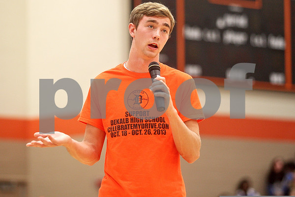 Monica Maschak - mmaschak@shawmedia.com<br /> Senior Will Ferguson urges his peers to register with CelebrateMyDrive.com during an assembly at DeKalb High School on Thursday, October 17, 2013. The Barbs could potentially win $100,000 and a free Kelly Clarkson concert depending on the amount of students and community members that pledge to drive safely every day from October 18 through 26.
