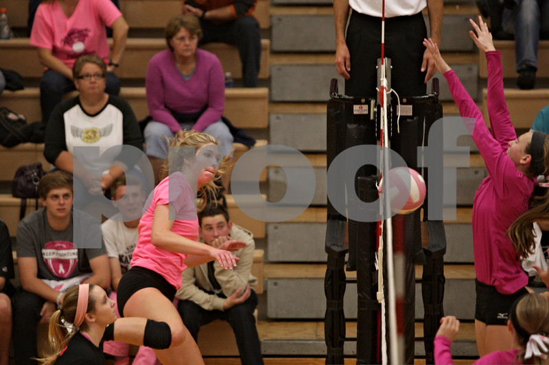 Rob Winner – rwinner@shawmedia.com<br /> <br /> DeKalb's Courtney Bemis has a successful kill during the second game against Kaneland on Tuesday, Oct. 15, 2013. DeKalb defeated Kaneland, 25-17 and 25-15.