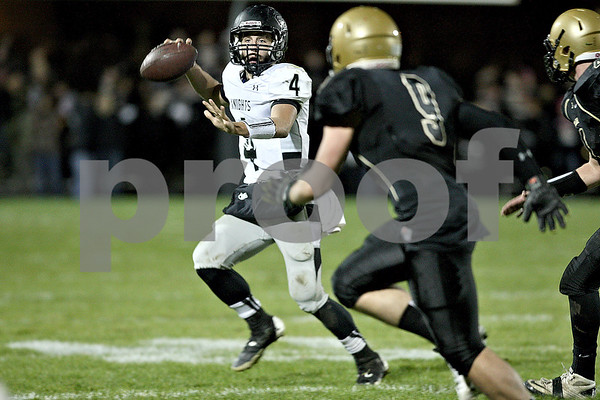 Monica Maschak - mmaschak@shawmedia.com<br /> Quarterback Drew David looks for an open teammate in the second quarter between the Spartans and the Knights on Friday, October 18, 2013.