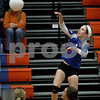 Monica Maschak - mmaschak@shawmedia.com<br /> Bridget Halat returns the ball in the second set against Richmond-Burton on Tuesday, October 22, 2013. The Cogs lost the match.