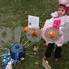 Rob Winner – rwinner@shawmedia.com<br /> <br /> Addelyn Foster, 4, holds her pumpkin entry on the lawn of the DeKalb County Courthouse at the Sycamore Pumpkin Festival in Sycamore, Ill., Wednesday, Oct. 23, 2013.