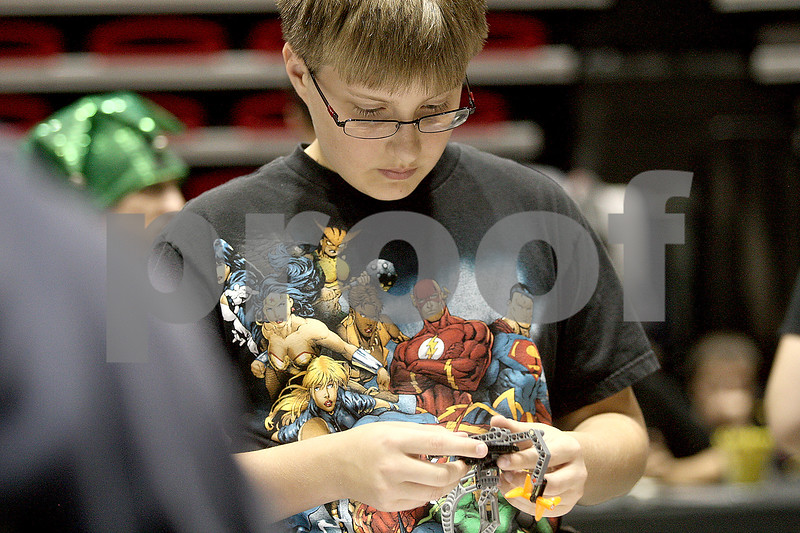 Monica Maschak - mmaschak@shawmedia.com<br /> Mark Bauer, 12, builds robotics with Legos at this year's Annual Celebration of Science, Technology, Engineering and Math (STEM) at  the Northern Illinois University Convocation Center on Saturday, October 19, 2013.