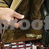 Rob Winner – rwinner@shawmedia.com<br /> <br /> Dennis Leifheit, owner of ZZ Cop's Gun Room in Sycamore, Ill., shows a concealed firearm in a holster covered by a jacket at his business on Friday, Oct. 18, 2013.