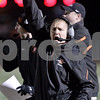 Monica Maschak - mmaschak@shawmedia.com<br /> Coach Matt Weckler celebrates a touch down that breaks the tie in the second quarter against Rochelle on October 25, 2013.