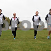 Monica Maschak - mmaschak@shawmedia.com<br /> Seniors Monica York, Kayla Federici, Kelsey Schrader and Sara Schafer run during cross country practice on Tuesday, October 22, 2013. Paced by a strong senior class, DeKalb is seeking to get back to the state meet as a team for the first time since 2011. They will run at the Class 2A Burlington Central Regional on Saturday.