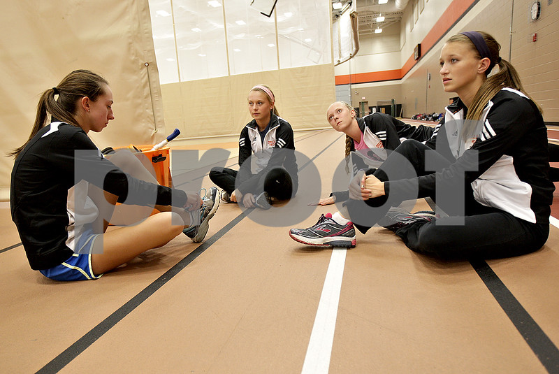 Monica Maschak - mmaschak@shawmedia.com<br /> Seniors Sara Schafer, Kelsey Schrader, Kayla Federici and Monica York finish warming up before cross country practice on Tuesday, October 22, 2013. Paced by a strong senior class, DeKalb is seeking to get back to the state meet as a team for the first time since 2011. They will run at the Class 2A Burlington Central Regional on Saturday.