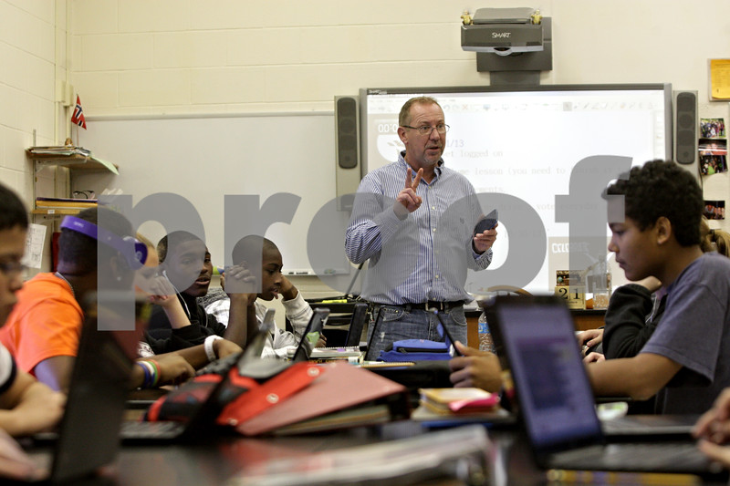 Rob Winner – rwinner@shawmedia.com<br /> <br /> Roger Christensen, a teacher at Clinton Rosette Middle School in DeKalb, instructs his classroom on using laptops for a science lab on Monday, Oct. 21, 2013.