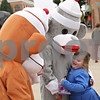 Rob Winner – rwinner@shawmedia.com<br /> <br /> Tiffany Heath, 7, of Sycamore hugs a sock monkey on the corner of State and Maple streets near the DeKalb County Courthouse in Sycamore, Ill., on Wednesday, Oct. 23, 2013.