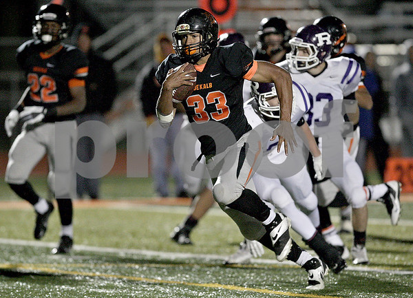 Monica Maschak - mmaschak@shawmedia.com<br /> Halfback Dre Brown gains yardage in the second quarter against Rochelle on October 25, 2013.