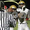 Rob Winner – rwinner@shawmedia.com<br /> <br /> Sycamore's Riley Hurley (right) tosses the football to the official after his touchdown run during the first quarter in Yorkville, Ill., Friday, October 25, 2013.
